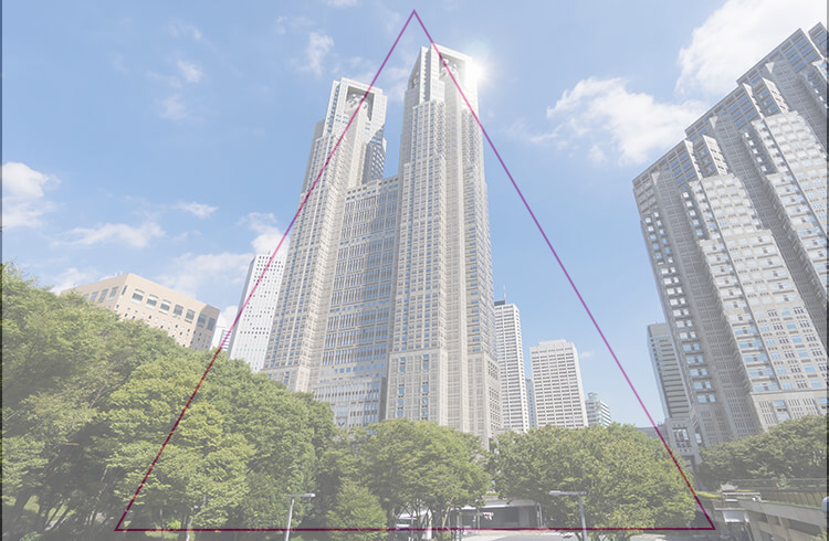 三角構図におさめたビル群の写真