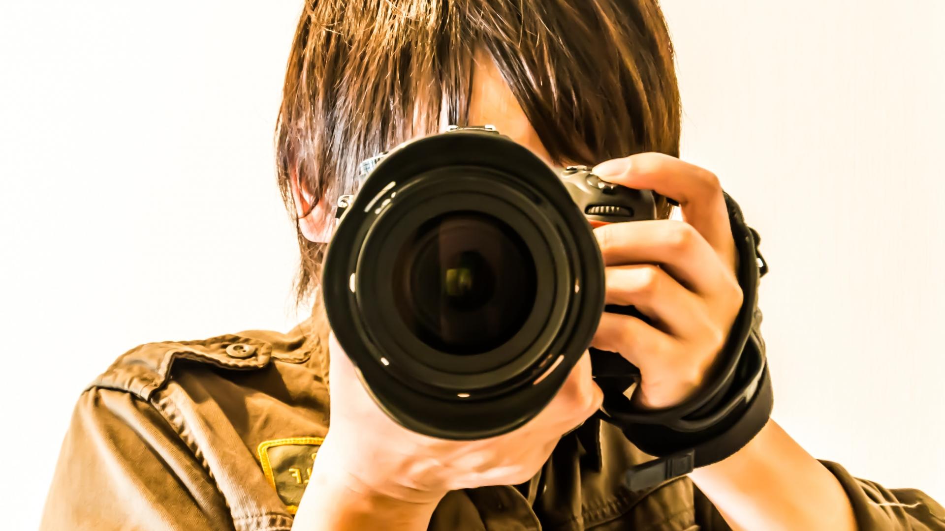 撮影するカメラマンのイメージ